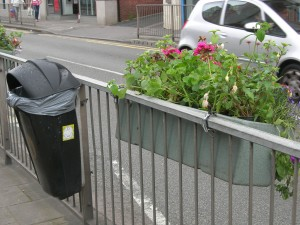 Plant Display, Acocks Green style.  Same Birmingham City Council brand green fibre glass containers, note.  No comment!!