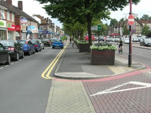 Shirley, Stratford Road, Red Route, Raised road surface for pedestrians crossing, trees and flower boxes on reservation strip