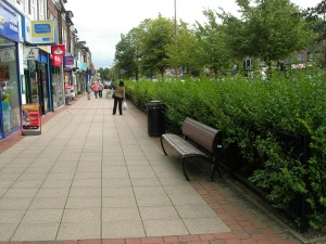 Shirley, Stratford Road Red Route - Hedge and benches for shoppers, good surfacing.